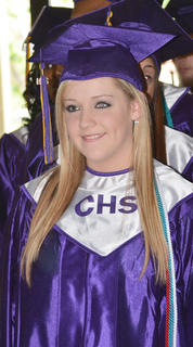 Aerial Milby smiles as she walks in during Saturday's ceremony.