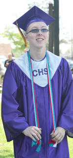 Daniel Rainwater smiles as he prepares to line up with his classmates to begin Saturday's ceremony.