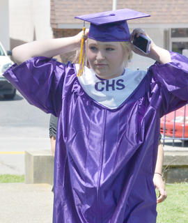 Sarah Matherly makes a final adjustment to her cap before the start of Saturday's ceremony.