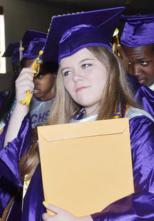 Christan Hodges turns her tassel to signify that she is now a high school graduate.
