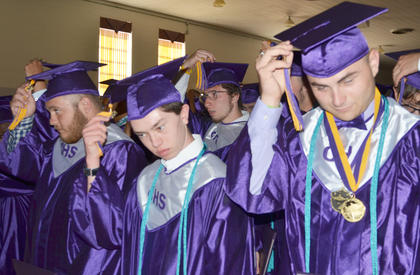 From left, students Dalton Couch, Ethan Cox and Dakota Cravens turn their tassels, which signifies that they have been declared graduates. In back is Glen Hooper.