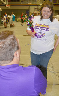 Yolanda Osinger laughs as she proposes marriage to Dan Durham as part of a dare at project graduation.