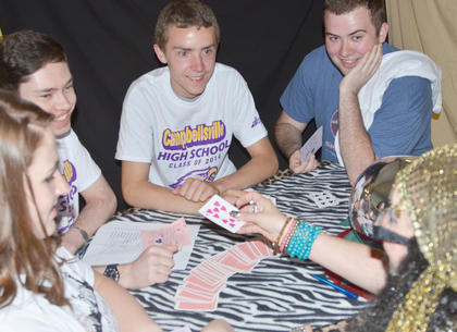 From left, students Mollie Williams, Ethan Cox, Nathan Riggs and Ethan Bailey hear their fortunes from a psychic.