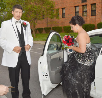 Clayton Russell and his date, Cassie Squires, get their valet parking tickets as the start of the CHS prom.