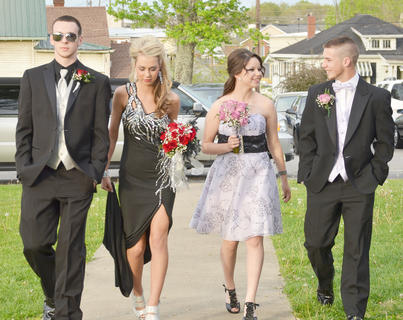 From left, Codie Bryant, Savannah Graham, Cheyenne Young and Hayden Webb walk together as the CHS prom gets underway on Saturday night.