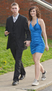 Harley Roberts and Catarina Ashcraft hold hands as the CHS prom gets underway on Saturday night.