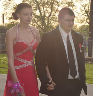 Samantha McElroy and Corey Sneed hold hands as the CHS prom gets underway on Saturday night.