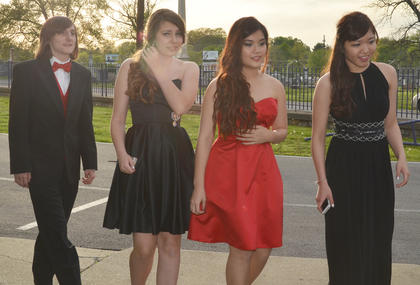 From left, CHS students Wayne Draper, Norina Pommerening, Catherine Michaels and Sherry Chen walk together as their prom gets underway Saturday night.