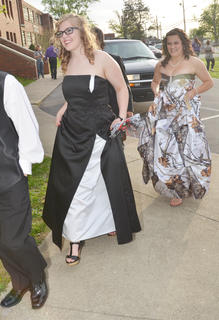 Destiny Atkinson, in front, and Sidney Lamer smile as they walk together as the CHS prom gets underway.