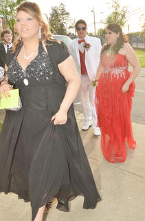Yolanda Osinger, in front, and Jacob Marples and his date, Victoria Bailey, walk together as the CHS prom gets underway.