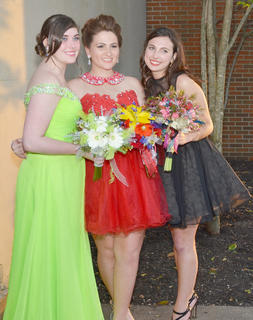From left, CHS students Chelsie Edwards, Mollie Williams and Katelyn McMahan smile as they pose for a photo together.