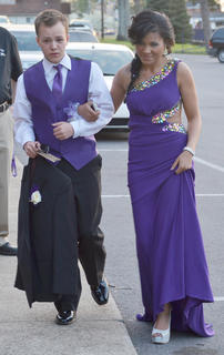 Josh Welch and his date, Gabby Mitchell, wear purple to the CHS prom on Saturday night.