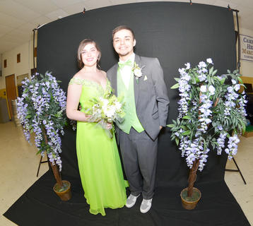 CHS students Chelsie Edwards and Logan Graham smile as they pose for their official prom photo on Saturday.