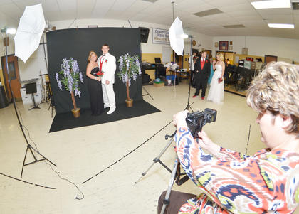 Katilyn Bryant and Dylan Bright smile as Valerie Davis, media specialist at CHS, takes their official prom photo.