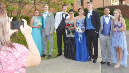 From left, CHS students Katie VanOrder, J.T. Holmes, Clayton Russell, Cassie Squires, Casey Sallee, Austin Hash, Tony Barrera and Caroline McMahan smile as a parent takes their photo.