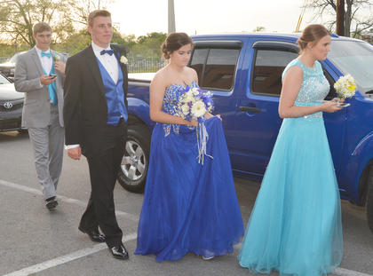 From left, CHS students J.T. Holmes, Austin Hash, Casey Sallee and Katie VanOrder walk together as their prom gets underway Saturday night.