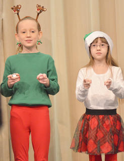 "CMS Choir members perform ""A Big Red Fella in the Chimney."""