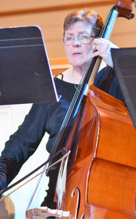 Julie Caldwell of Campbellsville, secretary for special projects at CU, plays double bass with the Chamber Orchestra.