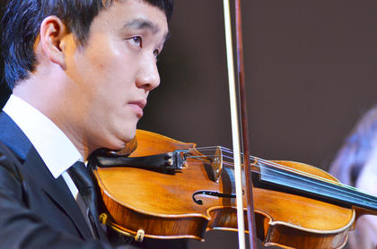Guang Jim, concertmaster, of China, plays violin with the Chamber Orchestra.