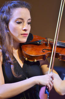 Maria Constanza Boso Galli of Argentina plays violin with the Chamber Orchestra.