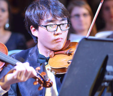 Zhihuan An of China plays violin with the Chamber Orchestra.