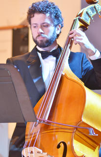 Andrey Junca Gonçalves of Brazil plays the double bass with the Chamber Orchestra.
