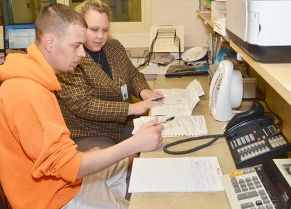 Inmate Joseph Cockerham talks with Class D Coordinator Mary Cox about finding a place for him to attend rehabilitation.