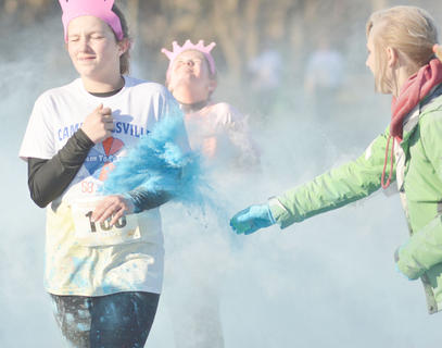 Participants are splashed as they complete this year's Color to Conquer race.