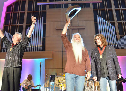 The Oak Ridge Boys take a bow after performing on Monday night. From left are Joe Bonsall, William Lee Golden and Richard Sterban.