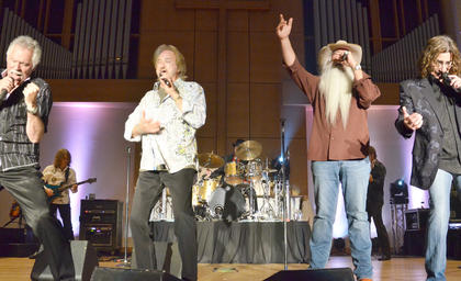The Oak Ridge Boys, from left, Joe Bonsall, Duane Allen, William Lee Golden and Richard Sterban, sing one of their hit songs.