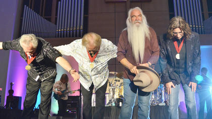 The Oak Ridge Boys take a bow after performing on Monday night. From left are Joe Bonsall, Duane Allen, William Lee Golden and Richard Sterban.