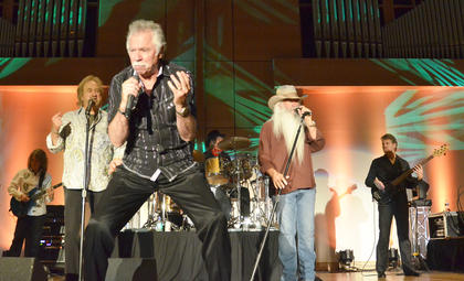 The Oak Ridge Boys, from left, Duane Allen, Joe Bonsall and William Lee Golden, sing to the crowd.