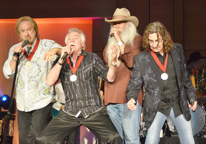 The Oak Ridge Boys, from left, Duane Allen, Joe Bonsall, William Lee Golden and Richard Sterban, sing one of their hit songs.