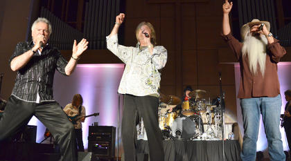 The Oak Ridge Boys, from left, Joe Bonsall, Duane Allen and William Lee Golden, sing to the crowd.