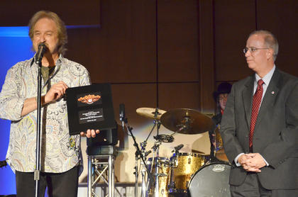 Duane Allen presents CU president Dr. Michael Carter a plaque recognizing CU as an official venue of The Oak Ridge Boys' 40th anniversary tour.