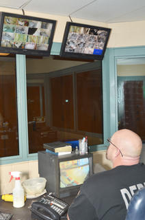 Deputy Tony Harris monitors the control room at the detention center. Harris can see all the cameras that are installed to watch the inmates.