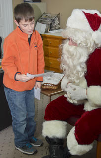 Isaac Garrison, who won third place in the letter-writing contest, reads his letter to Santa.