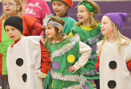 "Front, from left, Keaton Hord, Madie Gebler and Alyssa Bennett, and, in back, Gracie Pendleton, Tye Rhodes and Maylee Wilds dance to ""Must Be Santa."""