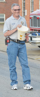 Randy Bricken Sr. collects donations outside Campbellsville and Taylor County Fire & Rescue headquarters.
