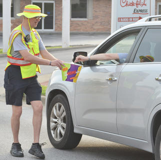 Tony Grider says thanks to a passerby for a donation.