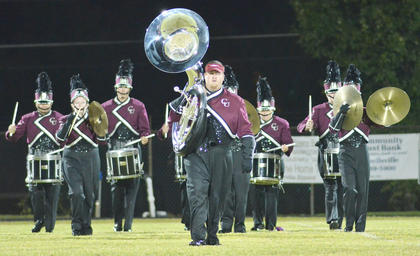 Zach Cox of Campbellsville, a tuba player for the CU marching band, leads his fellow bandmates on the field to perform.
