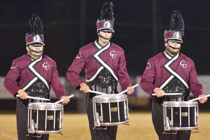 From left, Sam Geralds of Tompkinsville, Kyle Becknell of Lexington and Alex Bradley of Munfordville play snare drum with the CU marching band drumline.
