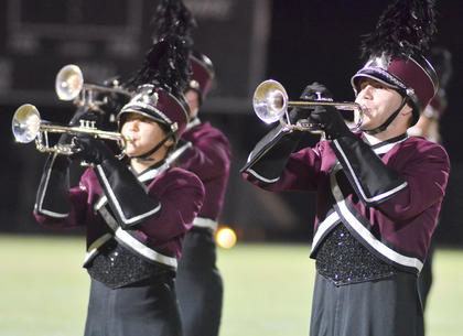 At left, Saori Kataoka of Japan and Blake Herron of Campbellsville play trumpet with the CU marching band.