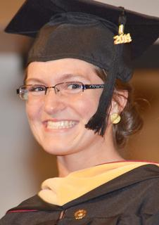 Rachel Moran of Campbellsville smiles as she receives her Master of Social Work degree.