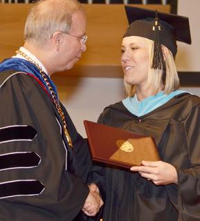 Sarah Beth Newton Hayes of Campbellsville receives congratulations from CU President Dr. Michael Carter as she receives her Teacher Leader Master of Arts in Education degree.