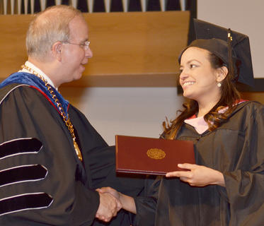 Danielle Batista Silva De Souza of Campbellsville receives congratulations from CU President Dr. Michael V. Carter as she receives her Master of Arts in Music degree.