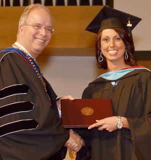 Lauryn Cox of Campbellsville receives congratulations from CU President Dr. Michael V. Carter as she receives her Teacher Leader Master of Arts in Education degree.