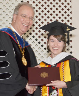 Jacqueline Nelson of Campbellsville receives congratulations from CU President Dr. Michael V. Carter as she receives her Bachelor of Science degree in political science and history.