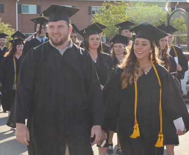 Graduates participate in the Graduate Walk, the last time they will walk across the CU campus as students.