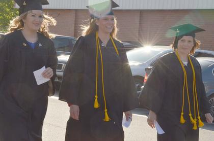 From left, Ashley Keith of Monticello, Erika Davis Hays of Greensburg and Ashley Lamkin of Raywick participate in the Graduate Walk, the last time they will walk across the CU campus as students.
